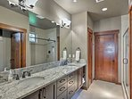 Freshen up at the double vanity during the day.