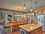 The dining area offers comfortable seating for 8 guests.