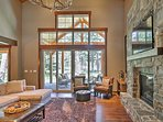 A stone fireplace and flat-screen cable TV highlight the living room.