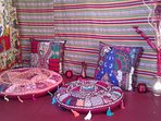 Colourful, Comfy Cushions and Ghaddis in Lounge Area