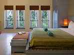 Bedroom 3 with views to a  lovely coconut plantation