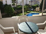 View of pool - small table & chairs