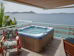 Hot tub on upper deck and Carriben Sea.