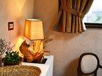 Bed and Breakfast naturAS - La Casetta nel Bosco. Dettagli della camera da letto