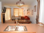 Open floor plan, seating for 4 at dining table, additional seating for 3 at the breakfast bar