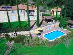 Aereal view of the Tuscan villa with swimming pool, jacuzzi and garden
