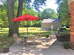 Large backyard with multiple patio dining areas, peaceful and relaxing area