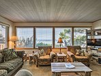 Unwind on the couches while admiring the ocean views or watching TV.