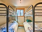 Two twin-over-twin bunk beds are perfect for kids or friends!