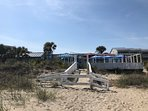 Beach entrance to The Deck, Tybee's ONLY beach dining! Live music, food, drink, gaze at the ocean...