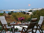 The rise of the full moon above the picturesque Naoussa
