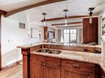 Full Kitchen with Granite Counter-tops