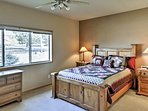 You're sure to sleep easy in this inviting master bedroom.