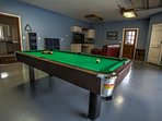 Spacious game room featuring a pool table