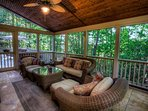 Screened in back porch with comfortable seating