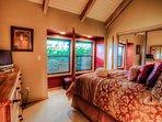 Main level bedroom with queen bed