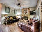 Comfortable family room with fireplace and TV