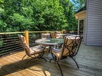Large back porch with comfortable outdoor seating
