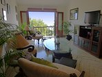 Television room with juliette balcony overlooking the Zuari River