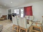 Enjoy delicious meals around the 6-person dining table.