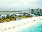 Drone aerial photo of entire villa complex, ocean and lagoon