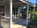 Deck for outdoor eating with barbecue close by