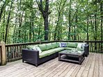 Relax on this large back deck in the woods