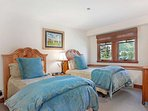 Bedroom 4 is furnished with 2 twin beds and also provides views to chair 2 and the tennis courts.