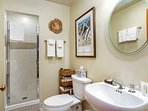 The master en suite includes a walk in shower for convenience and deep jetted tub for relaxation.