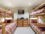 Bedroom 2, located near the master, has plenty of space for the kids! Twin over queen and twin over twin bunk beds.