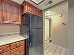 Modern appliances elevate this fully equipped kitchen.