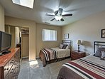 The second bedroom features 2 cozy twin beds.