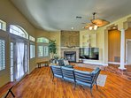 Hardwood floors and picture windows line the spacious rec room.