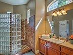 The en-suite bathroom features a tiled walk-in shower.