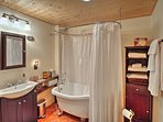 The en-suite bathroom features a beautiful clawfoot tub w/ showerhead.