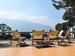 Sundeck out front at this Holiday Villa in Kasauli with views of the Shivalik range