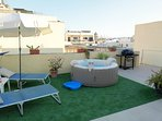 Private terrace with Mosta basilica dome views, a Jacuzzi where to relax or sip a glass of wine.