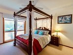 Extra large bedroom with magnificent 4 poster bed and fairylights for ambience and romance.