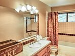 You'll find a shower/tub combo in the second full bathroom.