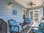 Enjoy great company and a glass of wine on the screened-in porch.