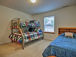 Choose between a spot on the twin-over-full bunk bed or the separate twin bed.