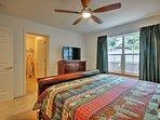 The master bedroom boasts a flat-screen TV, large closet, and en-suite bathroom.