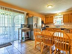 The kitchen is fully equipped and features stainless steel appliances.