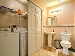 The property has a convenience washer, dryer and half-bath.