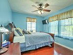The second bedroom boasts a queen bed and a flat-screen TV.