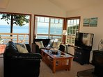 Living room that leads out onto outside deck - with panoramic views to the bay
