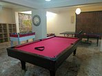 The huge games room in the cellar has a full size pool table, table tennis, table football and dart.