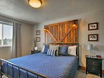 This rustic headboard completes the bedroom.