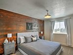 Trendy decor and wood paneling make up a second bedroom.