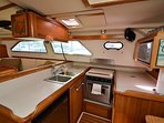 Plenty of cooking area and counter space.  This boat comes fully furnished